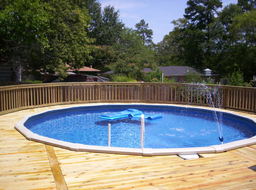 Pools minden bossier city shreveport la sunset decks for Above ground pool decks video